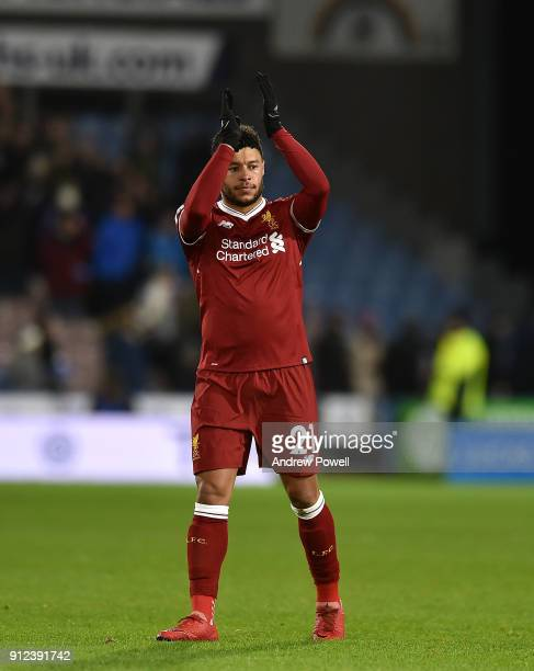 Alex OxladeChamberlain of Liverpool shows his appreciation to the fans at the end of the Premier League match between Huddersfield Town and Liverpool...