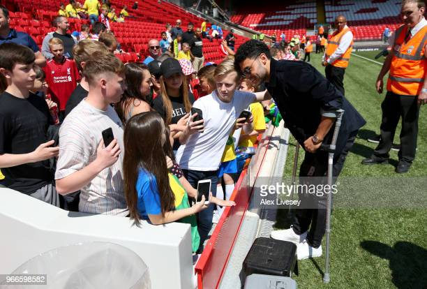 Alex OxladeChamberlain of Liverpool signs autographs prior to the International Friendly match between Croatia and Brazil at Anfield on June 3 2018...