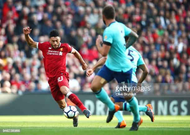 Alex OxladeChamberlain of Liverpool takes on the AFC Bournemouth defence during the Premier League match between Liverpool and AFC Bournemouth at...