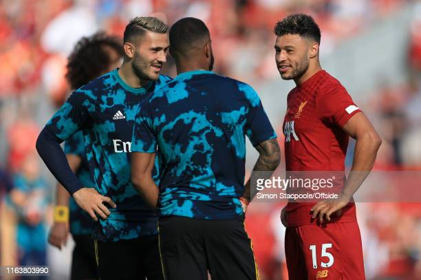Alex OxladeChamberlain of Liverpool talks to former teammate Sead Kolasinac of Arsenal before the Premier League match between Liverpool and Arsenal...