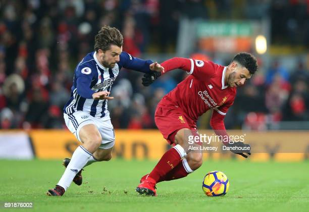 Alex OxladeChamberlain of Liverpool turns from Jay Rodriguez of West Bromwich Albion during the Premier League match between Liverpool and West...
