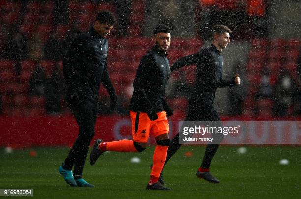 Alex OxladeChamberlain of Liverpool warms up prior during the Premier League match between Southampton and Liverpool at St Mary's Stadium on February...