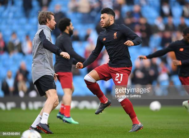 Alex OxladeChamberlain of Liverpool warms up prior to the UEFA Champions League Quarter Final Second Leg match between Manchester City and Liverpool...