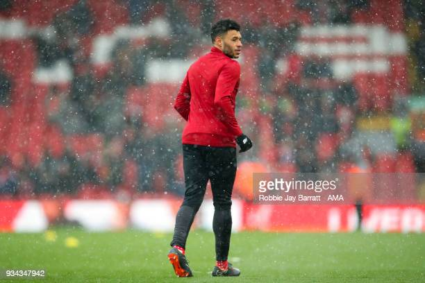 Alex OxladeChamberlain of Liverpool warms upon the snow prior to the Premier League match between Liverpool and Watford at Anfield on March 17 2018...