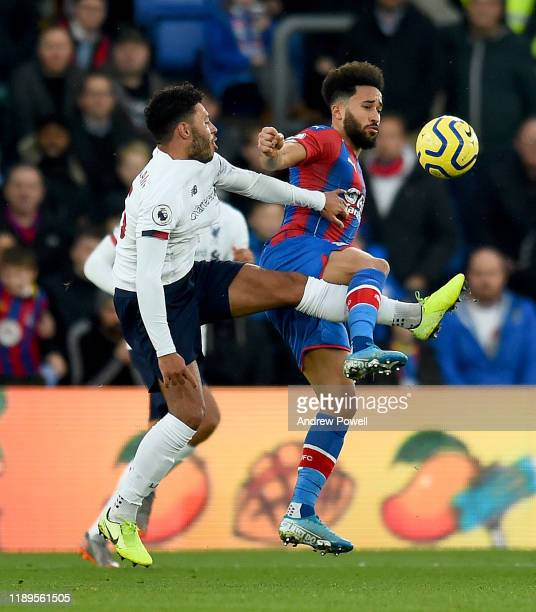 Alex OxladeChamberlain of Liverpool with Andros Townsend of Crystal Palace during the Premier League match between Crystal Palace and Liverpool FC at...