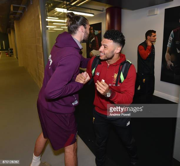 Alex OxladeChamberlain of Liverpool with Andy Carroll before the Premier League match between West Ham United and Liverpool at London Stadium on...