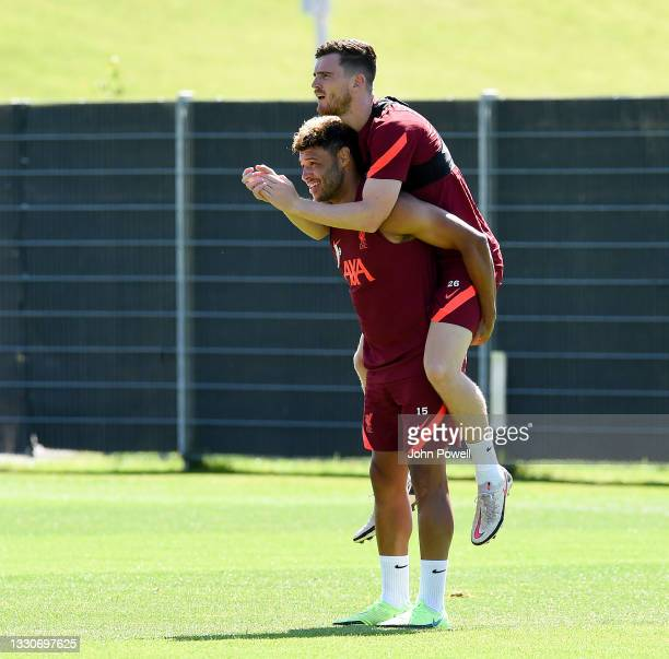 Alex Oxlade-Chamberlain of Liverpool with Andy Robertson of Liverpool during a training session on July 26, 2021 in UNSPECIFIED, Austria.