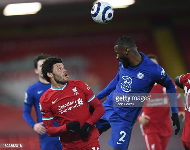 Alex Oxlade-Chamberlain of Liverpool with Chelsea's Antonio Rudiger during the Premier League match between Liverpool and Chelsea at Anfield on March...