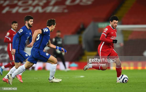 Alex Oxlade-Chamberlain of Liverpool with Chelsea's Cesar Azpilicueta during the Premier League match between Liverpool and Chelsea at Anfield on...