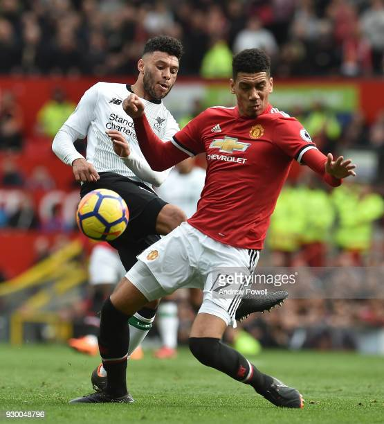 Alex OxladeChamberlain of Liverpool with Chris Smalling of Man Utd during the Premier League match between Manchester United and Liverpool at Old...