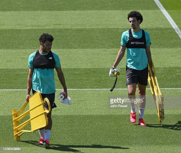 Alex OxladeChamberlain of Liverpool with Curtis Jones of Liverpool during a training session at Melwood Training Ground on May 20 2020 in Liverpool...