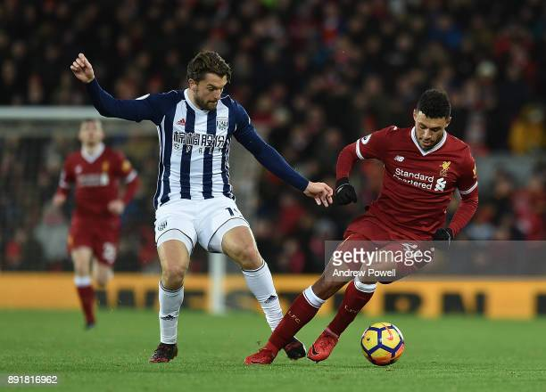 Alex OxladeChamberlain of Liverpool with Jay Rodriguez of West Brom during the Premier League match between Liverpool and West Bromwich Albion at...