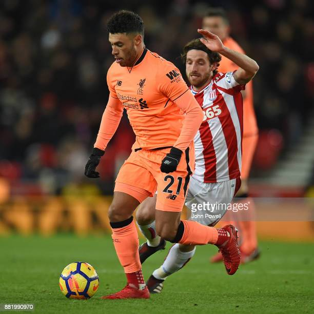 Alex OxladeChamberlain of Liverpool with Joe Allen of Stoke during the Premier League match between Stoke City and Liverpool at Bet365 Stadium on...