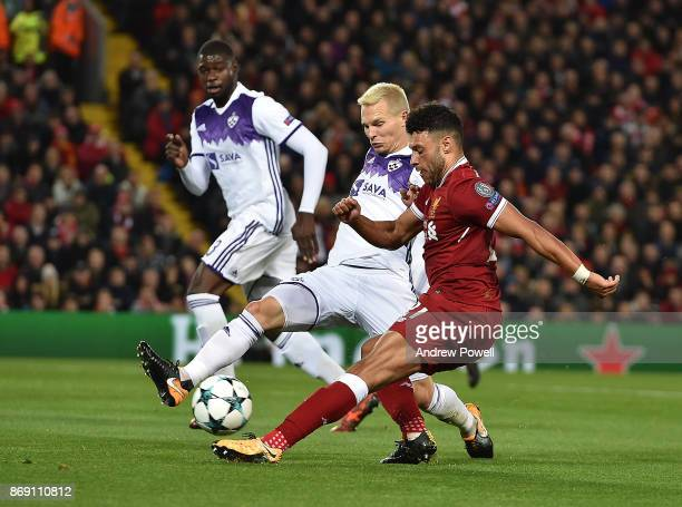Alex OxladeChamberlain of Liverpool with Martin Milec of Maribor during the UEFA Champions League group E match between Liverpool FC and NK Maribor...