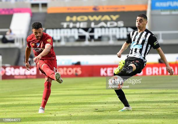Alex Oxlade-Chamberlain of Liverpool with Miguel Almiron of Newcastle during the Premier League match between Newcastle United and Liverpool FC at...