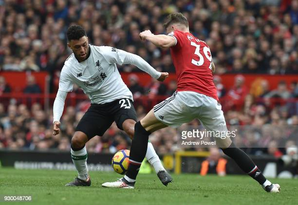 Alex OxladeChamberlain of Liverpool with Scott McTominay of Man Utd during the Premier League match between Manchester United and Liverpool at Old...