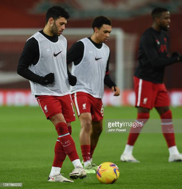 Alex Oxlade-Chamberlain of Liverpool with Trent Alexander-Arnold of Liverpool before the Premier League match between Liverpool and Burnley at...