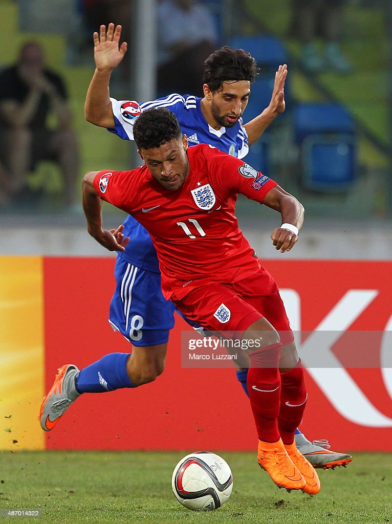 Alex Oxlade-Chamberlain of San Marino is challenged by Manuel Battistini (back) of England during the UEFA EURO 2016 Qualifier between San Marino and England at Stadio Olimpico on September 5, 2015 in San Marino, Italy.