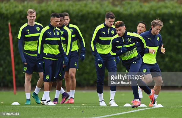 Alex OxladeChamberlain performs drills with team mates during an Arsenal training session on the eve of their UEFA Champions League match against...
