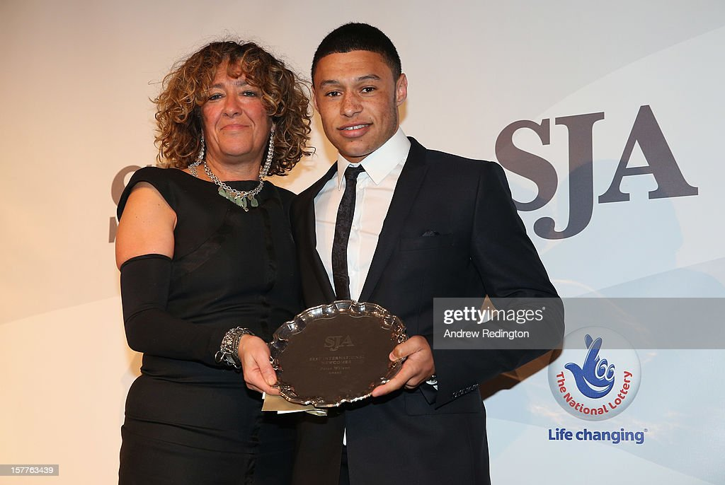 Alex Oxlade-Chamberlain (right) receives the Peter Wilson Award from Heather Rabbatts during the SJA 2012 British Sports Awards at The Pavilion at the Tower of London on December 6, 2012 in London, England.
