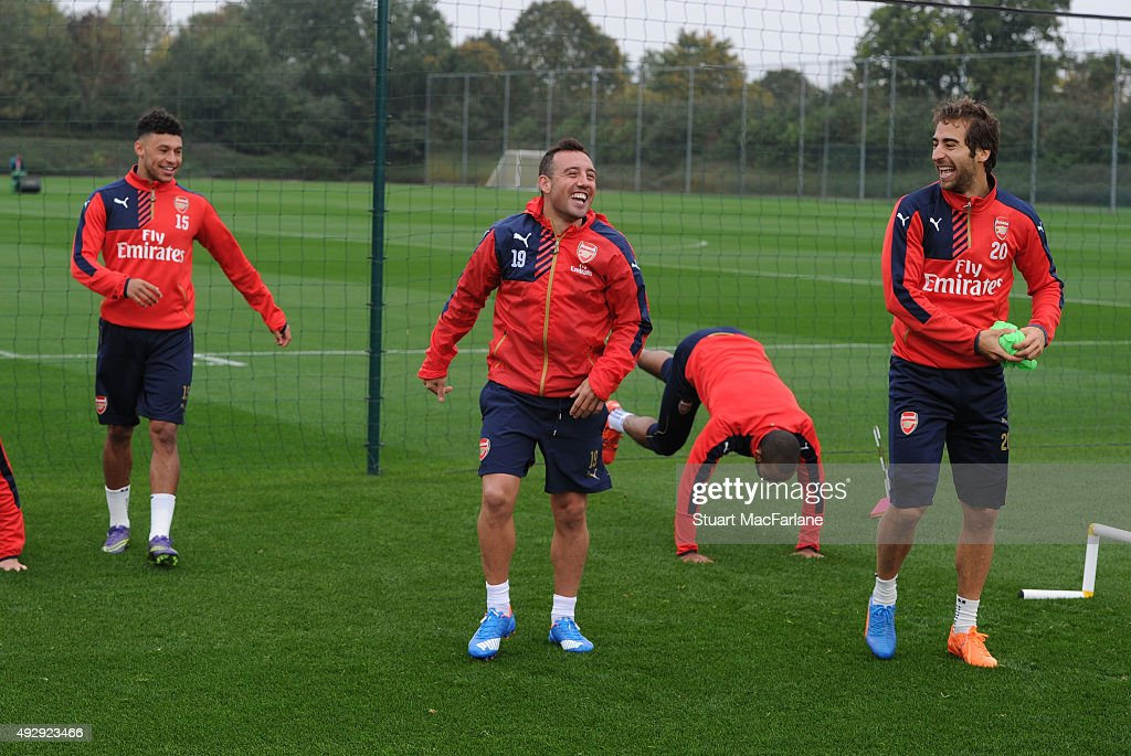 Alex Oxlade-Chamberlain, Santi Cazorla and Mathieu Flamini of Arsenal during a training session at London Colney on October 16, 2015 in St Albans, England.