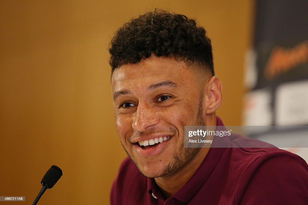 Alex Oxlade-Chamberlain speaks to the media during the England press conference at St Georges Park on September 2, 2015 in Burton-upon-Trent, England.