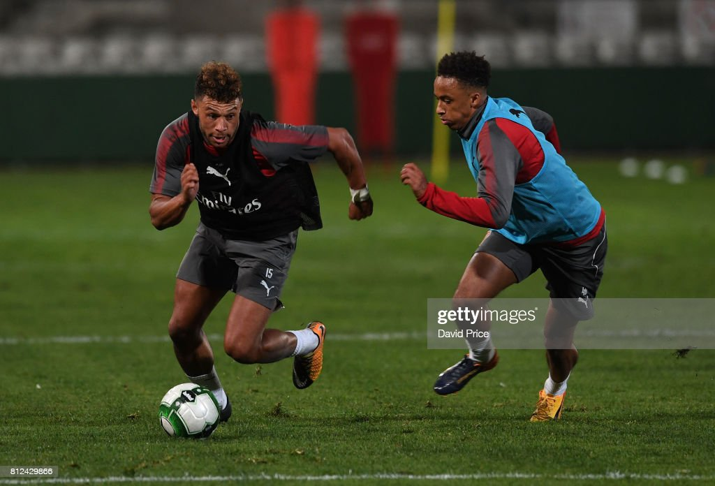 Alex Oxlade-Chamberlain takes on Cohen Bramall of Arsenal during the Arsenal Training Session at Koragah Oval on July 11, 2017 in Sydney, Australia.