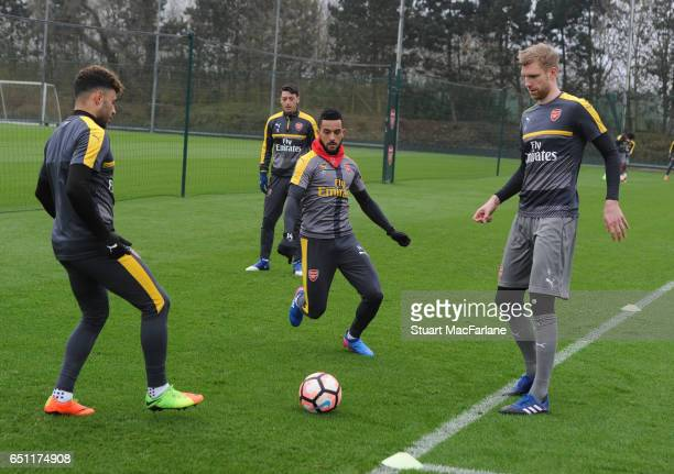 Alex OxladeChamberlain Theo Walcott and Per Mertesacker of Arsenal during a training session at London Colney on March 10 2017 in St Albans England