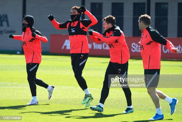 Alex Oxlade-Chamberlain, Trent Alexander-Arnold, Andrew Robertson and James Milner of Liverpool during a training session ahead of the UEFA Champions...