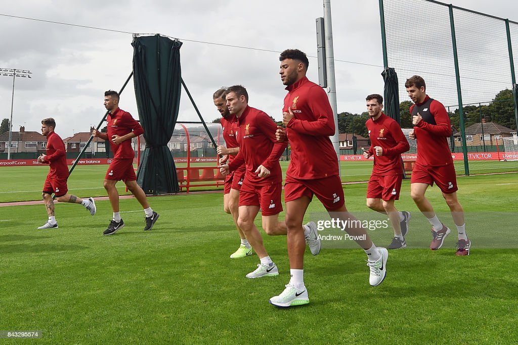 Alex Oxlade-Chamberlain warms up with team mates Jordan Henderson, James Milner, Alberto Moreno, Marko Grujic, Andrew Robertson, Jon Flanagan and Georginio Wijnaldum of Liverpool at Melwood Training Ground on September 6, 2017 in Liverpool, England.