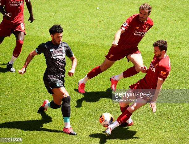 Alex OxladeChamberlain with Andy Robertson and Jordan Henderson captain of Liverpool during a training session at Anfield on June 01 2020 in...