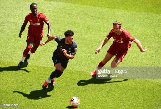 Alex OxladeChamberlain with Naby Keita and Jordan Henderson captain of Liverpool during a training session at Anfield on June 01 2020 in Liverpool...