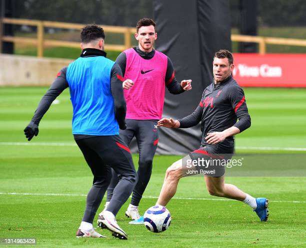 Alex Oxlade-Chamberlain,Andy Robertson and James Milner of Liverpool during a training session at AXA Training Centre on April 28, 2021 in Kirkby,...