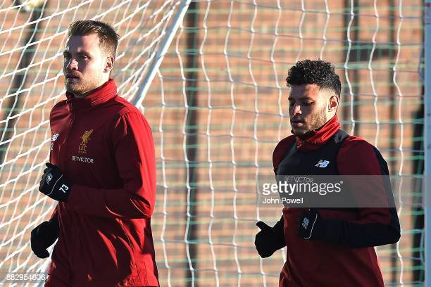 Alex OxladeCharmberlain and Simon Mignolet of Liverpool during a training session at Melwood Training Ground on November 30 2017 in Liverpool England