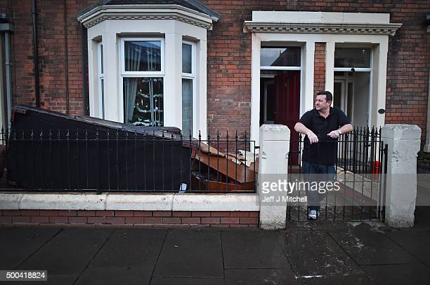 Alex Pagan stands outside his house in Broad street as people start to return to their properties after Storm Desmond caused flooding on December 8...
