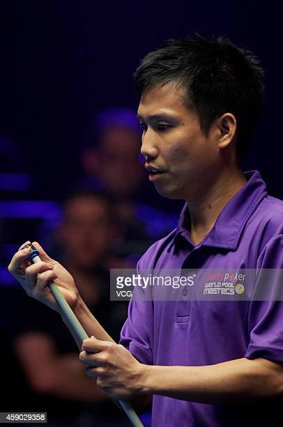 Alex Pagulayan of Canada chalks his cue against Darren Appleton of Great Britain on day one of the Partypoker World Pool Masters 2014 at Portland...