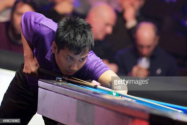 Alex Pagulayan of Canada plays a shot against Darren Appleton of Great Britain on day one of the Partypoker World Pool Masters 2014 at Portland...
