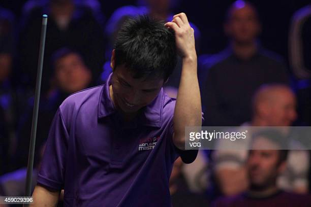 Alex Pagulayan of Canada reacts against Darren Appleton of Great Britain on day one of the Partypoker World Pool Masters 2014 at Portland Centre on...