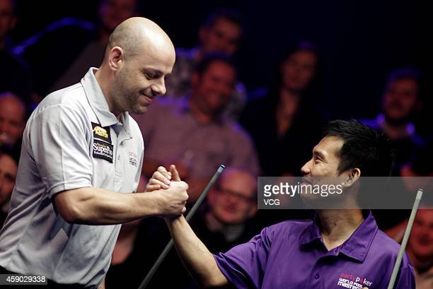 Alex Pagulayan of Canada shakes hands with Darren Appleton of Great Britain during their match on day one of the Partypoker World Pool Masters 2014...