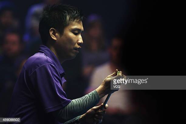 Alex Pagulayan of Philippines chalks his cue against Nikos Ekonomopoulos of Greece during day three of Partypoker World Pool Masters 2014 on November...