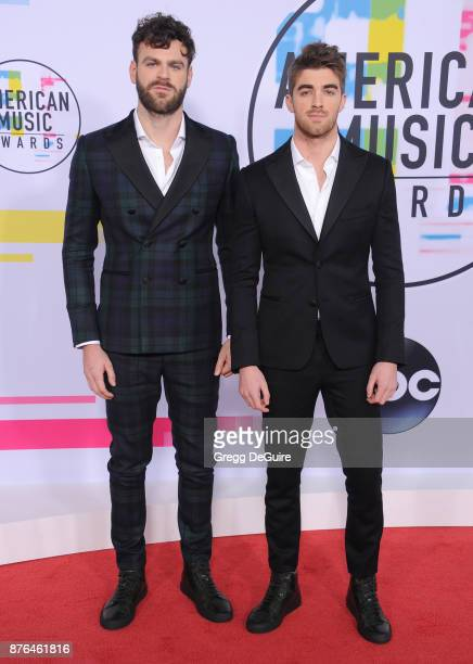 Alex Pall and Andrew Taggart of The Chainsmokers arrive at the 2017 American Music Awards at Microsoft Theater on November 19 2017 in Los Angeles...