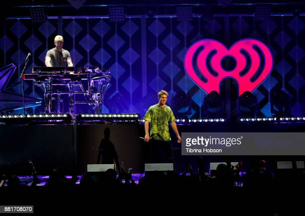 Alex Pall and Andrew Taggart of The Chainsmokers perform at 1061 KISS FM's iHeartRadio Jingle Ball 2017 at American Airlines Center on November 28...