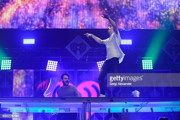 Alex Pall and Andrew Taggart of The Chainsmokers perform on stage during the Y100's iHeartRadio Jingle Ball 2016 at BBT Center on December 18 2016 in...