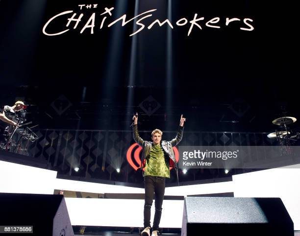 Alex Pall and Andrew Taggart of The Chainsmokers perform onstage at 1061 KISS FM's Jingle Ball 2017 Presented by Capital One at American Airlines...