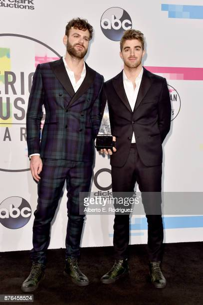 Alex Pall and Andrew Taggart of The Chainsmokers pose in the press room during the 2017 American Music Awards at Microsoft Theater on November 19...