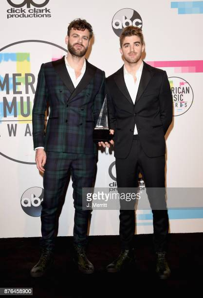 Alex Pall and Andrew Taggart of The Chainsmokers pose in the press room during 2017 American Music Awards at Microsoft Theater on November 19 2017 in...