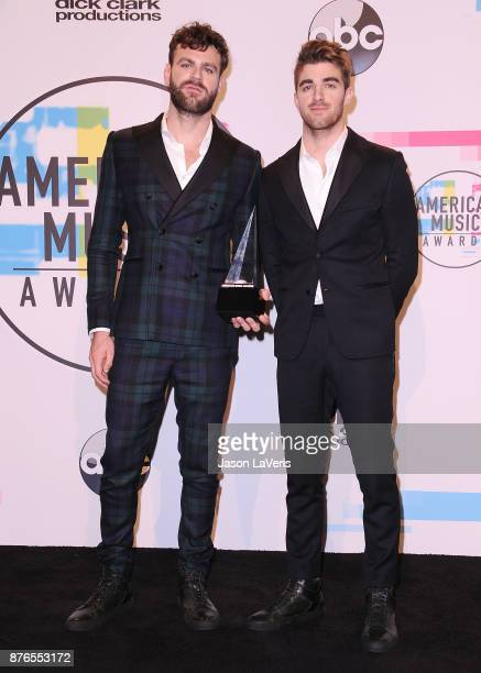 Alex Pall and Andrew Taggart of The Chainsmokers pose in the press room at the 2017 American Music Awards at Microsoft Theater on November 19 2017 in...