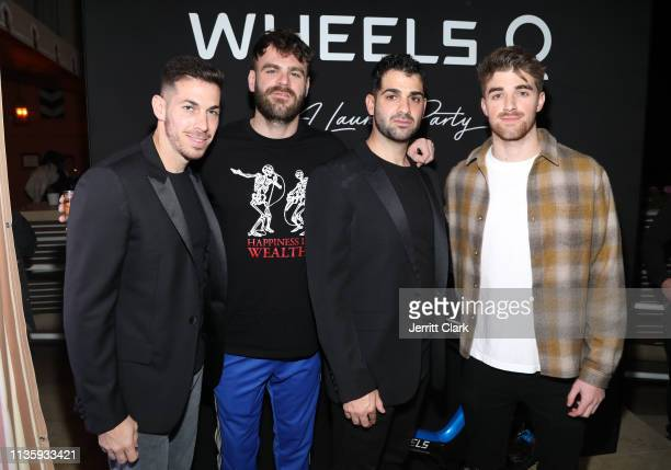 Alex Pall and Drew Taggart of The Chainsmokers poses with Wheels CoFounders Jon Viner and Josh Viner at the Wheels LA Launch at Sunset Tower on March...