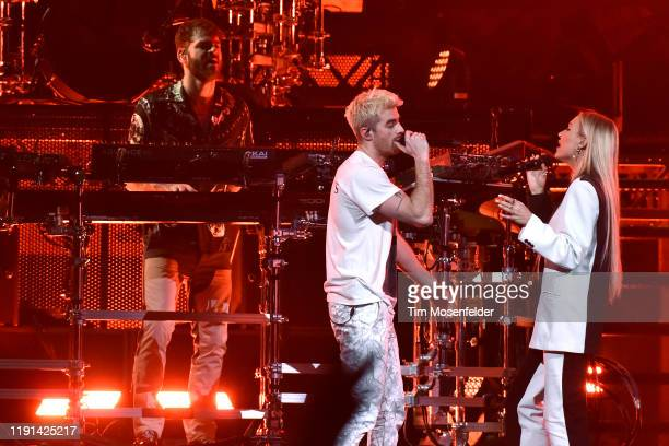 Alex Pall Drew Taggart of The Chainsmokers and guest Lennon Stella perform in support of the duo's World War Joy release at Golden 1 Center on...