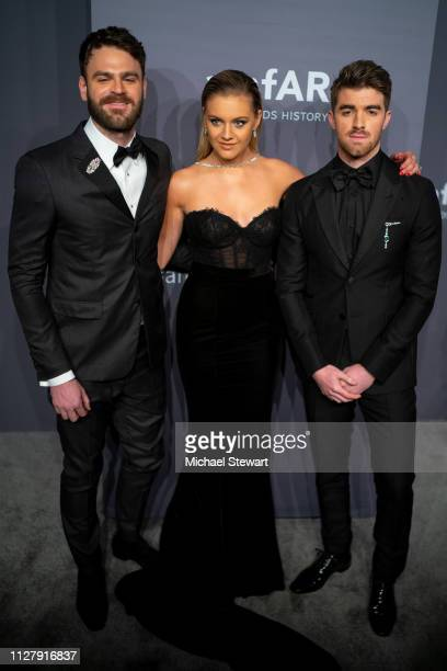 Alex Pall Kelsea Ballerini and Andrew Taggart attend the 2019 amfAR New York Gala at Cipriani Wall Street on February 06 2019 in New York City